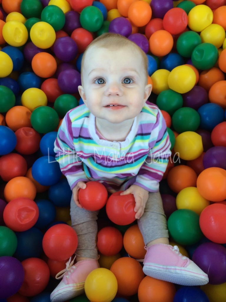 Baby Jo in the ball pit on the Bouncin' Bus