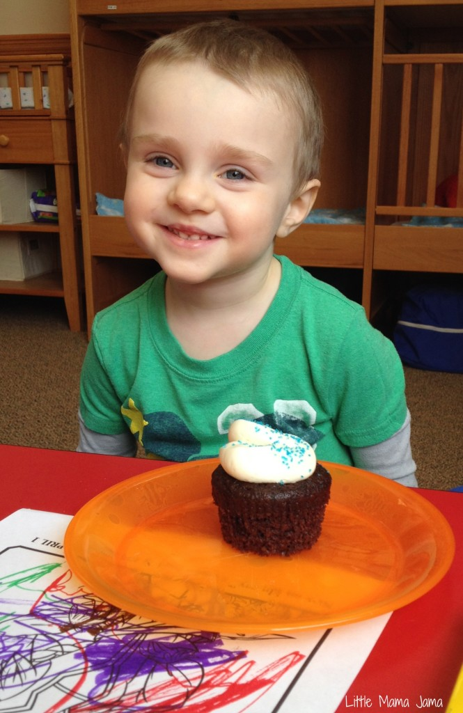 C enjoying a Blue Pixie Dust Cupcake #ProtectPixieHollow #shop