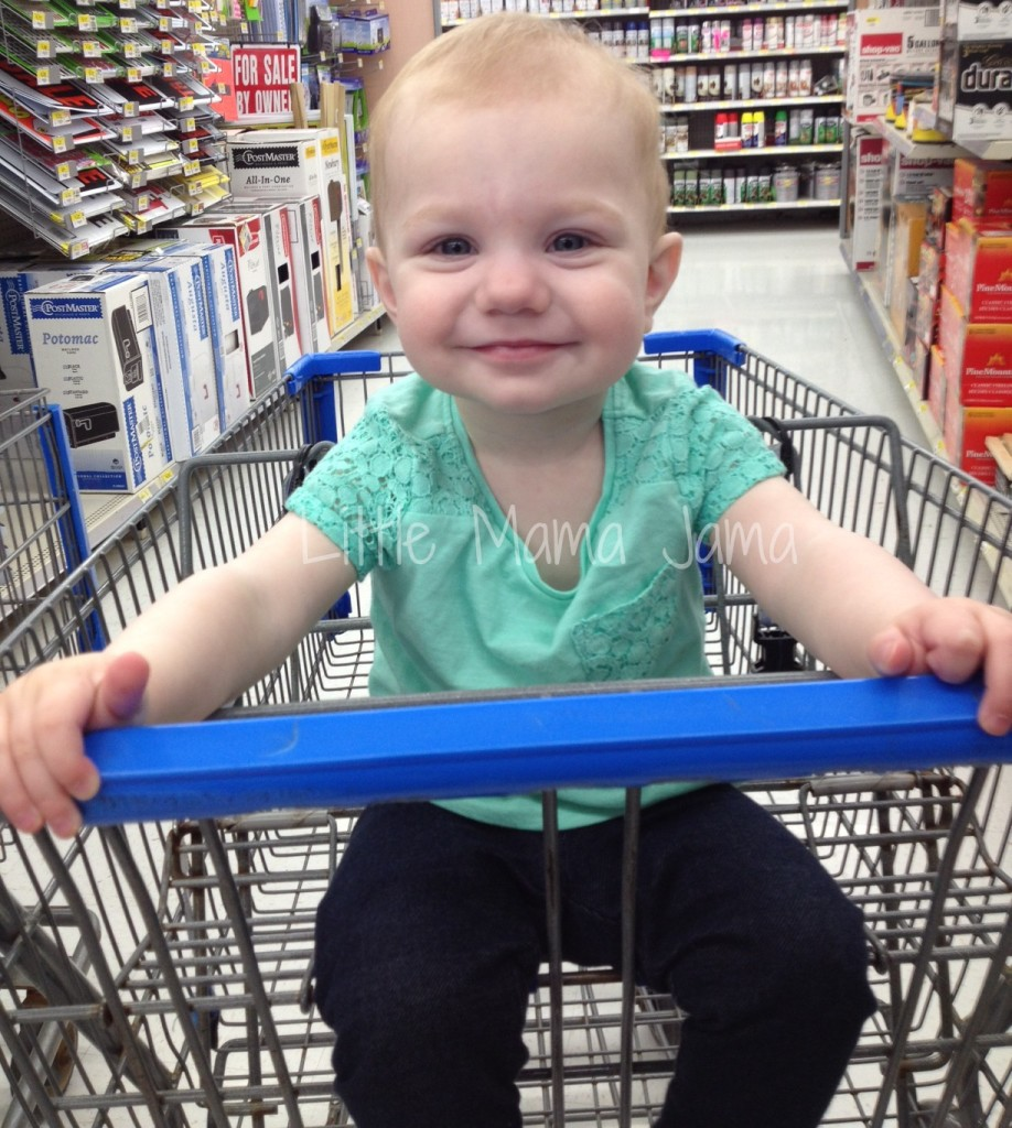 Baby Jo smiling in the shopping cart