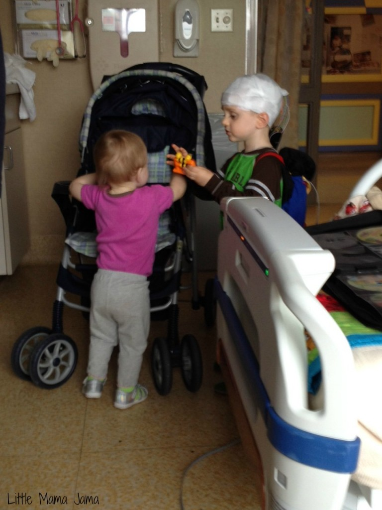 Siblings playing together at hospital
