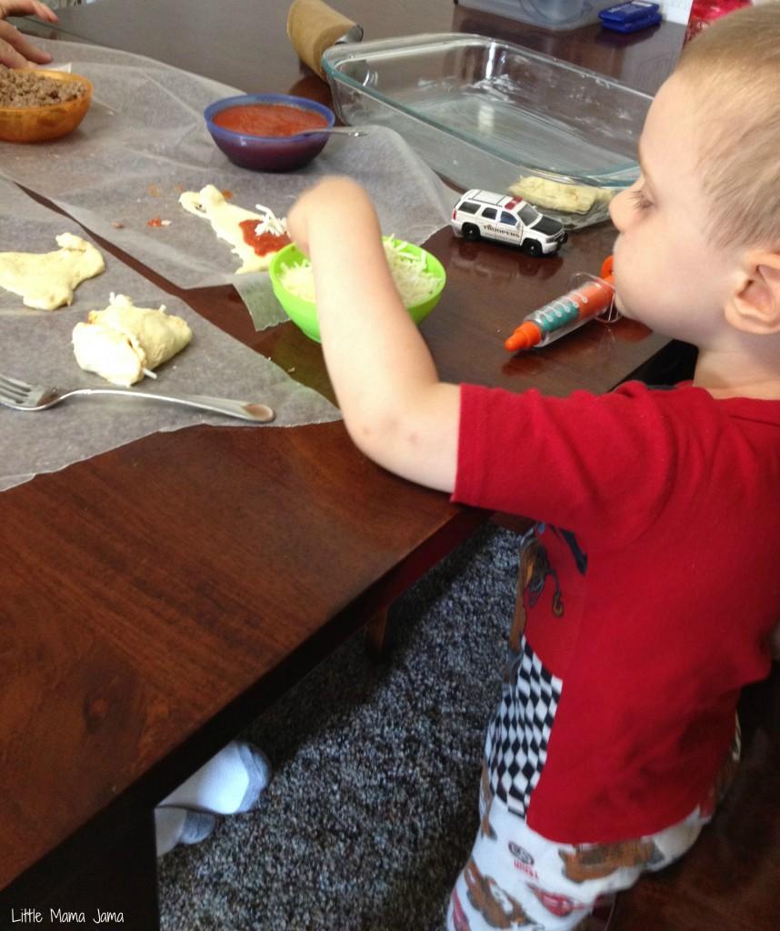 Toddler assembles mini sausage calzones #FamilyFavorites #shop #cbias