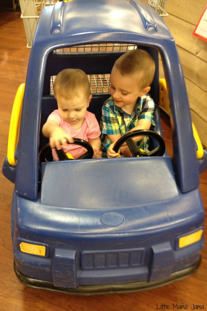 Toddlers ride in truck carts at Pick 'n Save #MyPicknSave #shop