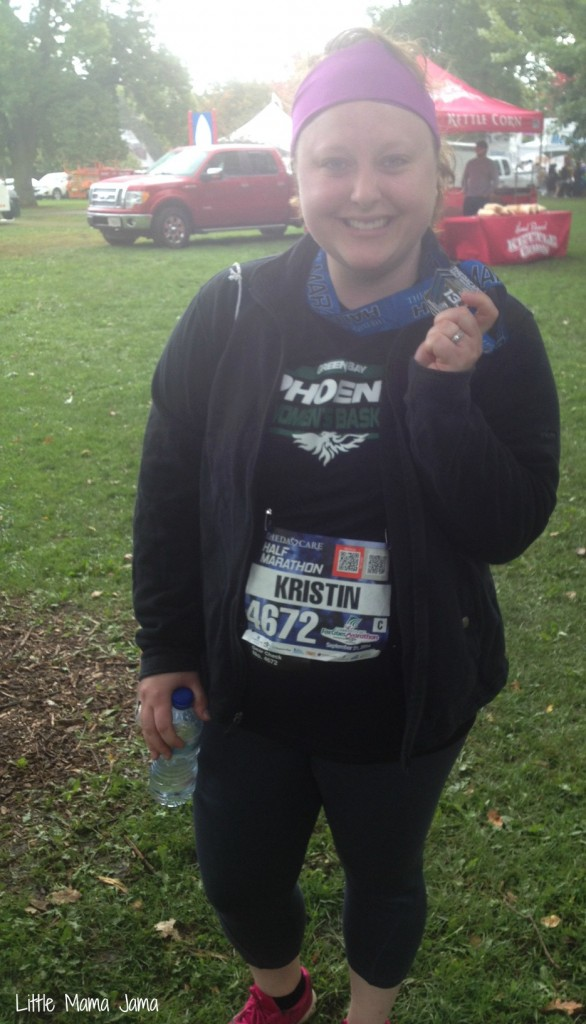 Kristin with medal after first half marathon