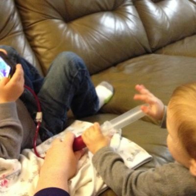 Baby Jo wants to help tube feed her big brother.