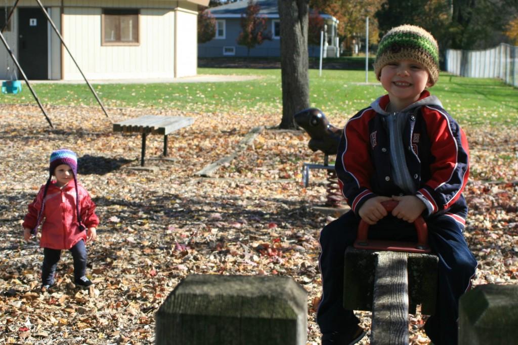 C rides teeter totter at park