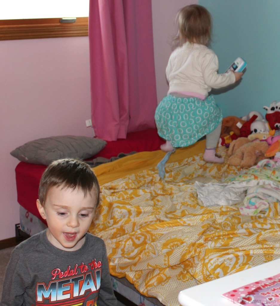 Baby Jo jumping on the bed