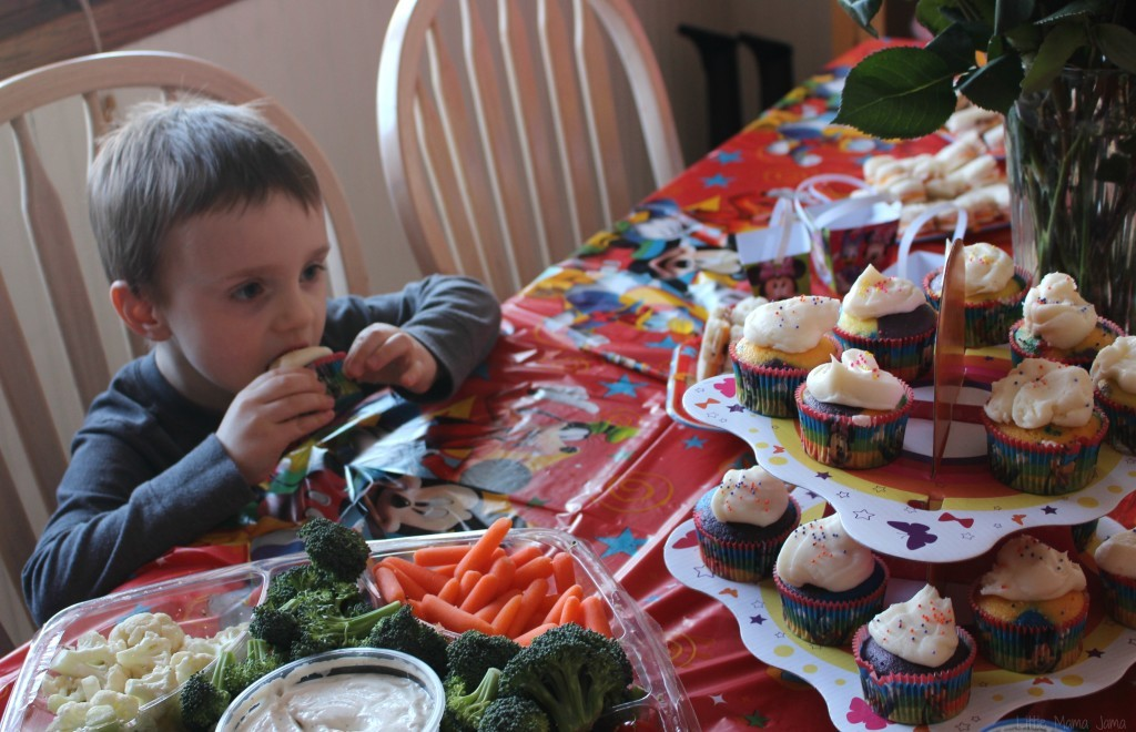 C eats cupcake at Mickey Mouse Clubhouse party #DisneySide #ad