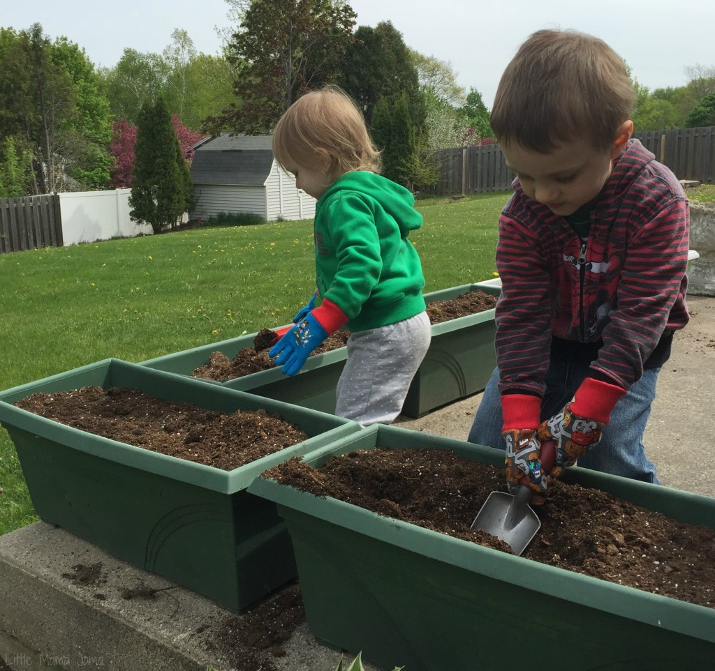 Baby Jo and C planting seeds