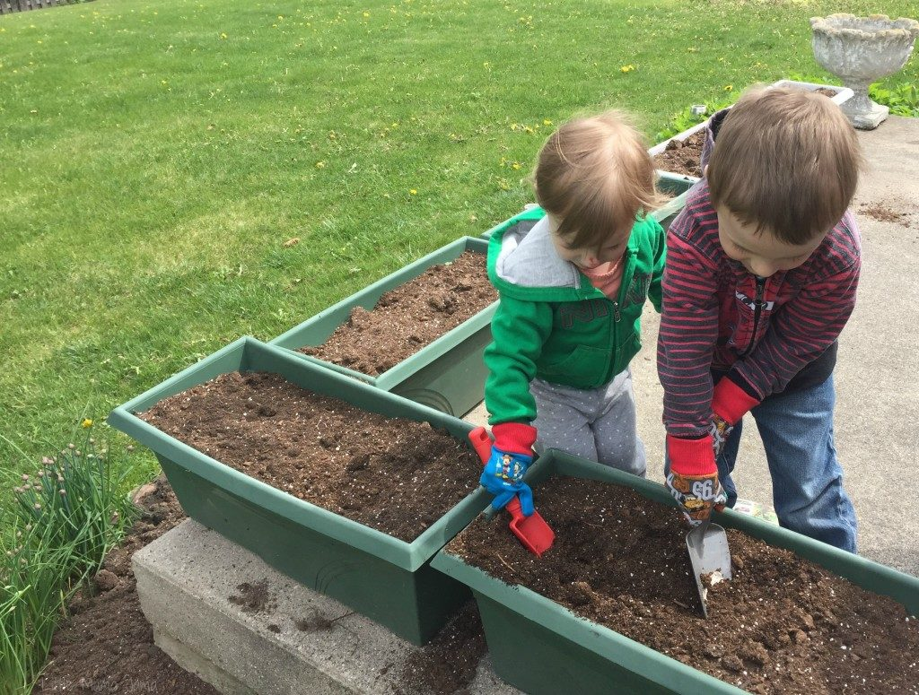 C and Baby Jo planting seeds