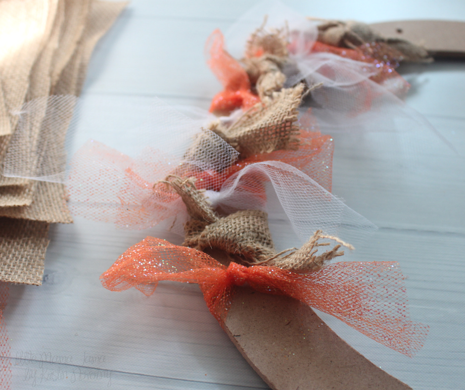 Tie the fabric around the wreath form to create your Burlap and Tulle Fall Wreath