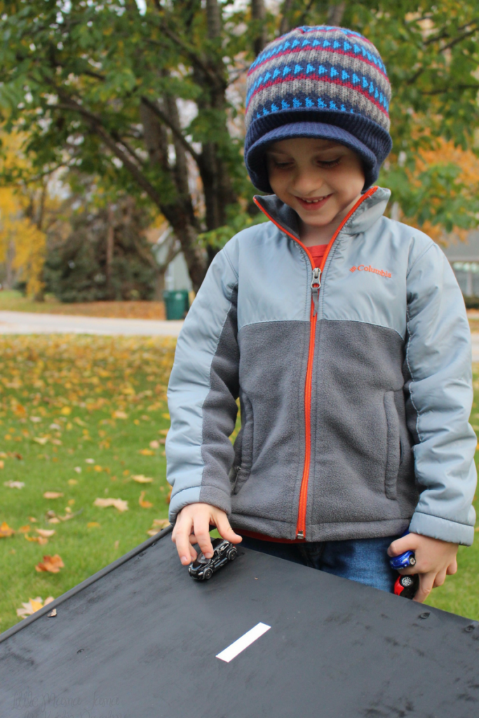 My son enjoys his new wooden ramp for racing his cars #RaceDayRelief #ad