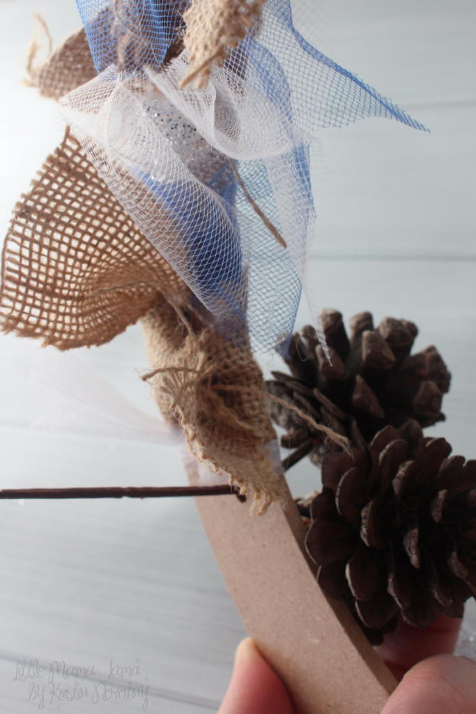 Place a pine cone floral pick in your winter wreath