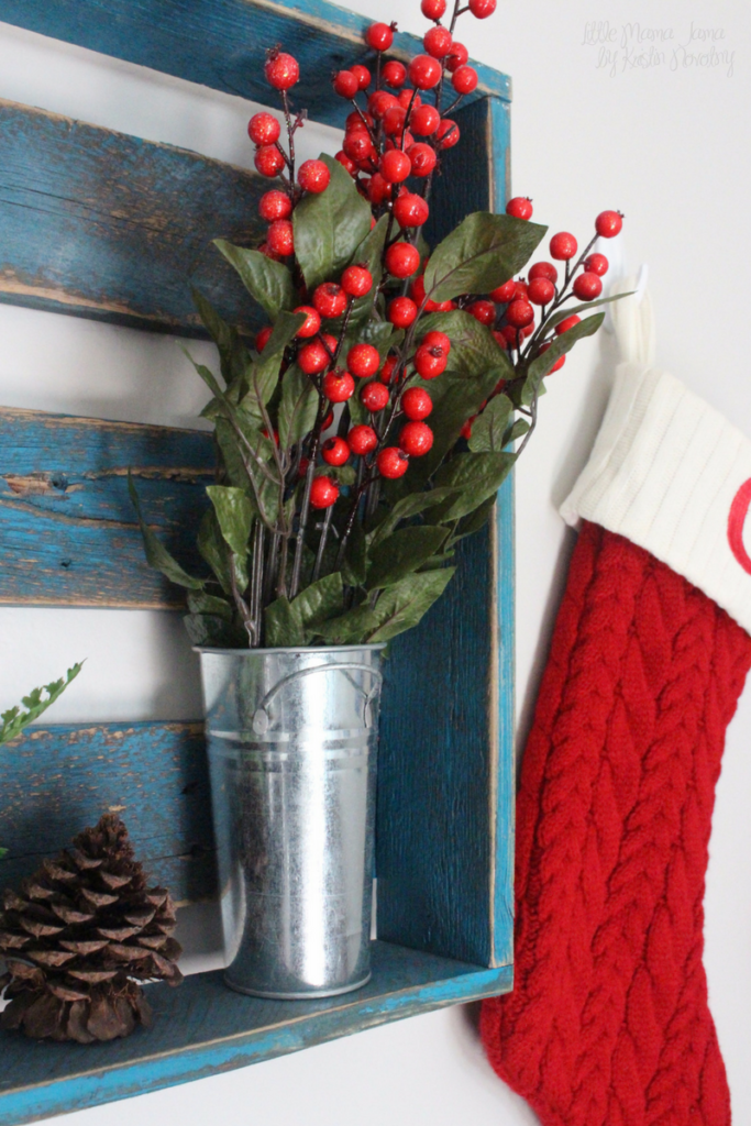Add a vase of red berries to your rustic holiday decor