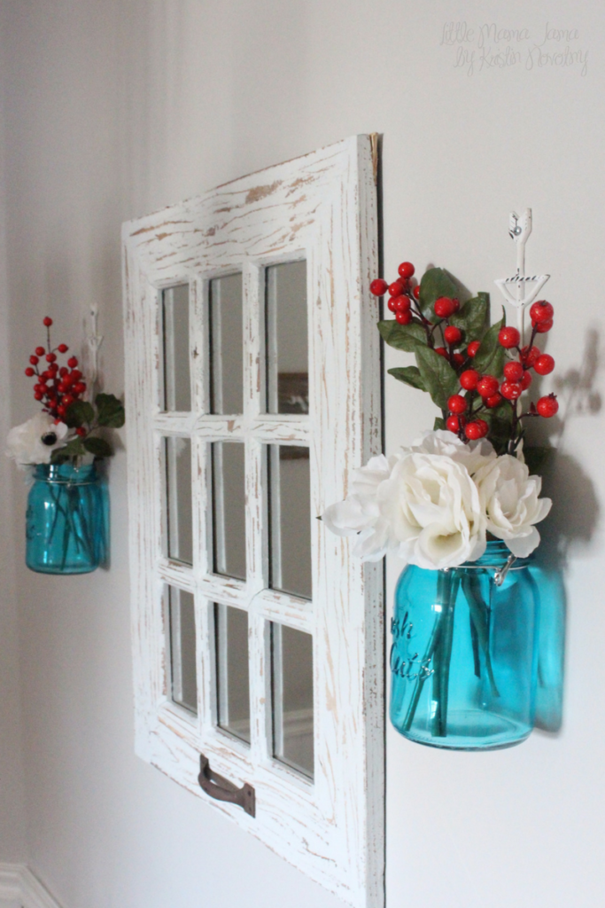 Rustic mason jar decor with window pane mirror and red and white floral display