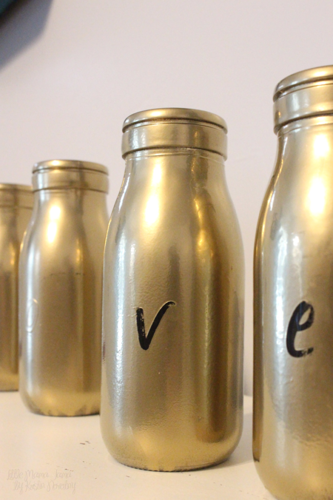 This easy DIY transforms milk bottles into gold vases
