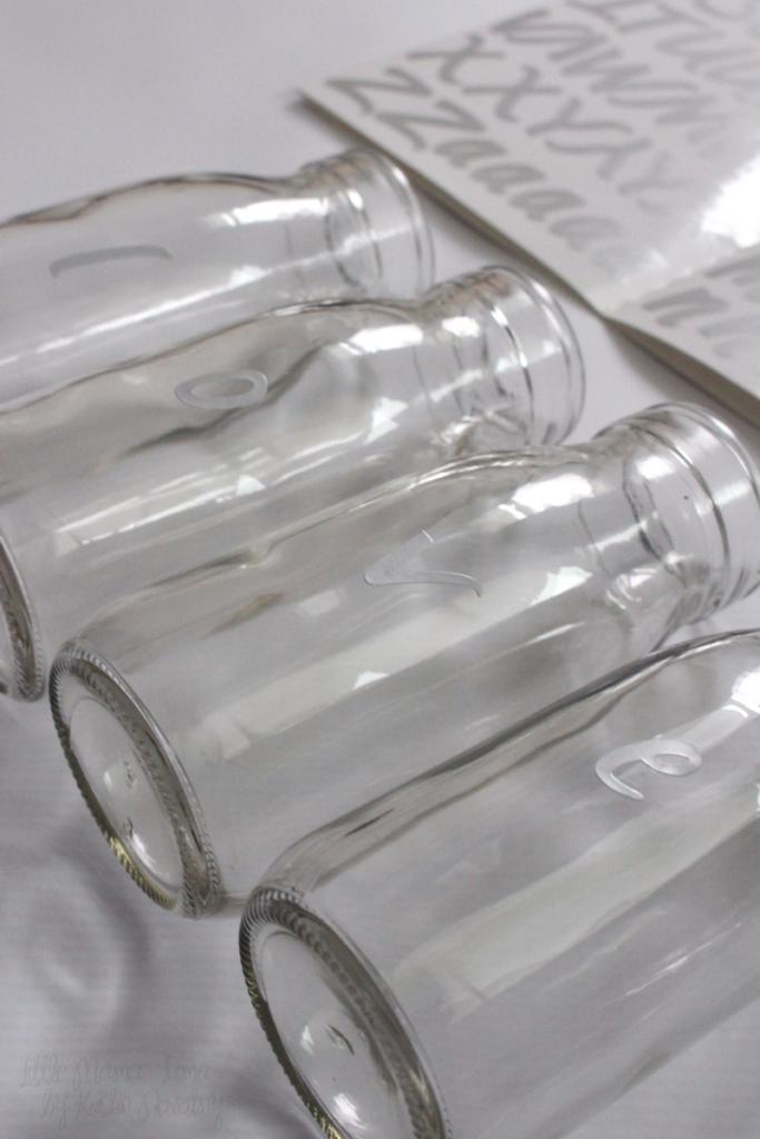 Spray paint glass milk bottles to create vases for Valentine's Day decor