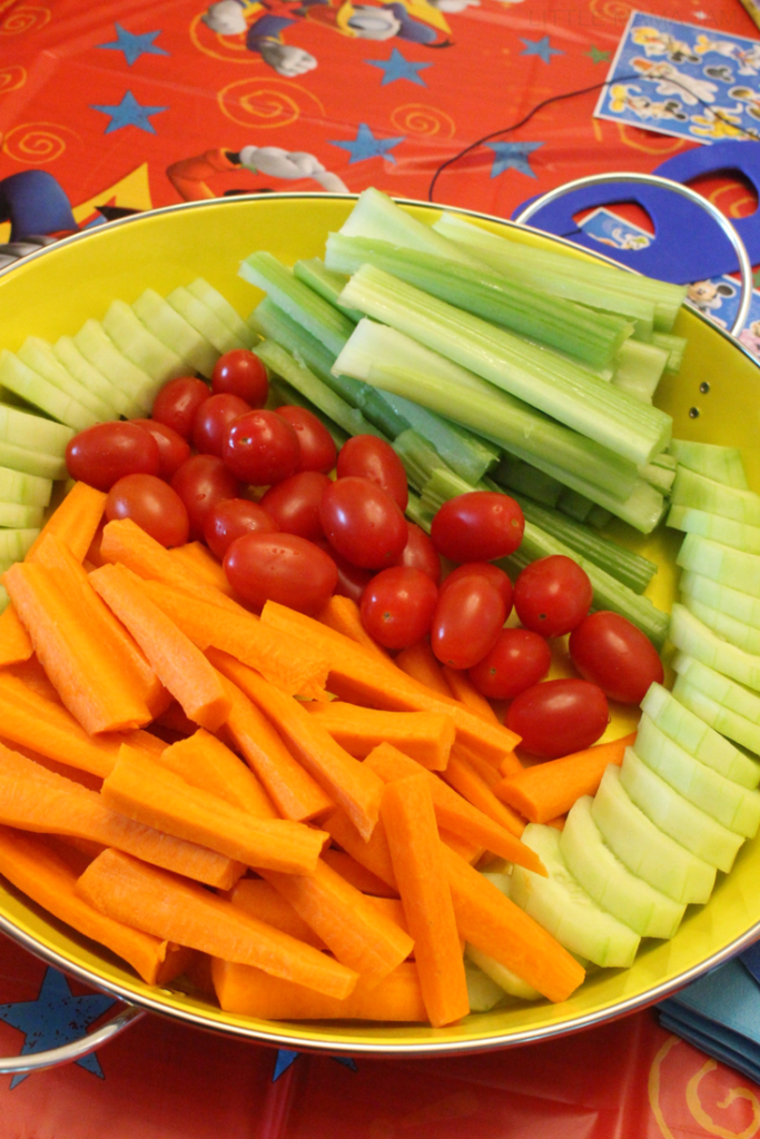 Veggie tray for healthy snack options at a no-stress Disney playdate for preschoolers! Click through for more tips. #DisneyKids #ad