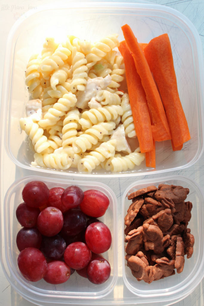 Use a bento box to create this easy, make-ahead school lunch with pasta salad, carrots, grapes and chocolate bunnies! Click through for more school lunch ideas. [ad]