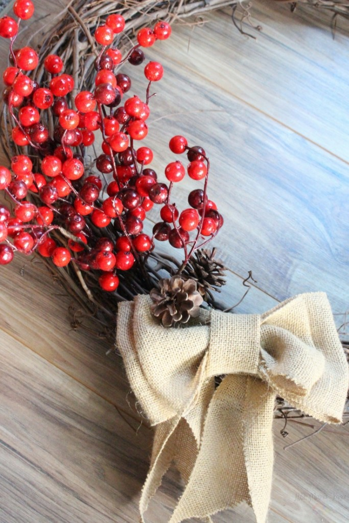 Put your touch on your rustic holiday home decor with this DIY Burlap and Cranberry Wreath. Bring festive joy to your front door! Click through for the tutorial.