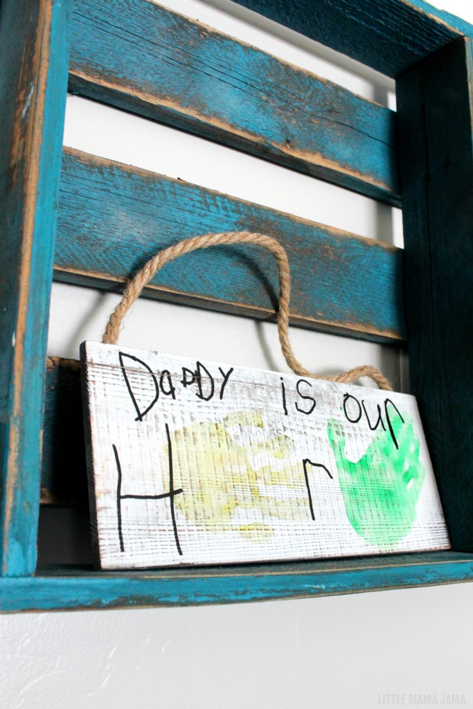 The kids can create this DIY sign with handprints and their own handwriting! Daddy is our hero sign is a cute birthday gift from kids or the perfect personalized Father's Day gift.